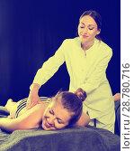Купить «Relaxing professional massage for young woman», фото № 28780716, снято 12 июня 2017 г. (c) Яков Филимонов / Фотобанк Лори