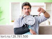 Купить «Young student man with hand injury in time management concept», фото № 28781500, снято 15 мая 2018 г. (c) Elnur / Фотобанк Лори