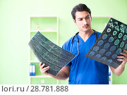 Купить «Young doctor working in the hospital», фото № 28781888, снято 17 мая 2018 г. (c) Elnur / Фотобанк Лори