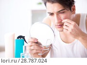 Купить «Young handsome man staring in the mirror», фото № 28787024, снято 23 ноября 2017 г. (c) Elnur / Фотобанк Лори