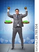Купить «Businessman trying to find balance between home and work», фото № 28789504, снято 18 января 2019 г. (c) Elnur / Фотобанк Лори