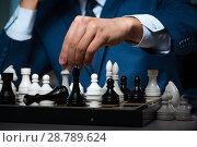 Купить «Businessman playing chess in strategy concept», фото № 28789624, снято 9 октября 2017 г. (c) Elnur / Фотобанк Лори