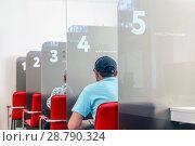 Купить «Interior of multifunctional services hall, Russia. Text in Russian: for all occasions.», фото № 28790324, снято 3 августа 2017 г. (c) Акиньшин Владимир / Фотобанк Лори