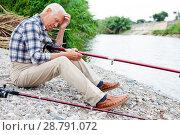 Купить «Aged man fishing at lakeside», фото № 28791072, снято 10 июня 2018 г. (c) Яков Филимонов / Фотобанк Лори