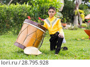 Купить «Young boy in Farmer's clothing hat and drum posing for camera in a photo shoot», фото № 28795928, снято 17 июля 2019 г. (c) age Fotostock / Фотобанк Лори