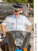 "Купить «Russia, Samara, September 2017: Soviet policeman in uniform on a Soviet police motorcycle ""Ural"" on a sunny day. The text in Russian: samara militia.», фото № 28803644, снято 16 сентября 2017 г. (c) Акиньшин Владимир / Фотобанк Лори"