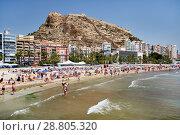 Купить «Tourists sunbathing on a Postiguet Beach of Alicante city. Spain», фото № 28805320, снято 26 июня 2018 г. (c) Alexander Tihonovs / Фотобанк Лори