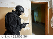 Купить «Special forces armed with pistol ready to attack», фото № 28805564, снято 19 июня 2015 г. (c) Дмитрий Калиновский / Фотобанк Лори