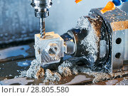 Купить «Milling metalworking process. Industrial CNC metal machining by vertical mill. Coolant and lubrication», фото № 28805580, снято 16 мая 2018 г. (c) Дмитрий Калиновский / Фотобанк Лори