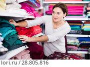 Купить «Woman choosing fabric», фото № 28805816, снято 4 января 2017 г. (c) Яков Филимонов / Фотобанк Лори