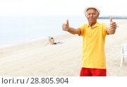 Купить «Satisfied active mature man giving thumbs up», фото № 28805904, снято 16 июня 2018 г. (c) Яков Филимонов / Фотобанк Лори