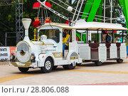 Купить «Children ride on the locomotive in the park. Cheboksary, Russia, 22/07/2018», фото № 28806088, снято 22 июля 2018 г. (c) Александр Якимов / Фотобанк Лори