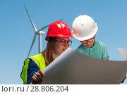 Купить «Concept of engineers and windmills», фото № 28806204, снято 16 июня 2018 г. (c) Pavel Biryukov / Фотобанк Лори