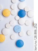 Купить «Different medical pills on white background.», фото № 28806252, снято 7 августа 2017 г. (c) Pavel Biryukov / Фотобанк Лори