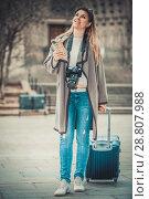 Купить «Young girl taking a journey in the city», фото № 28807988, снято 27 марта 2017 г. (c) Яков Филимонов / Фотобанк Лори