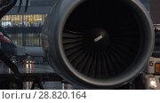 Купить «Engine of airplane and airport terminal in background», видеоролик № 28820164, снято 4 октября 2017 г. (c) Данил Руденко / Фотобанк Лори