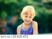 Купить «Portrait of happy girl outdoors», фото № 28820472, снято 20 июля 2017 г. (c) Яков Филимонов / Фотобанк Лори
