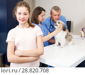 Купить «Happy girl with dog consulting by veterinarian», фото № 28820708, снято 3 мая 2018 г. (c) Яков Филимонов / Фотобанк Лори