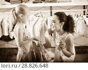 Купить «Mother with daughter buying clothes», фото № 28826648, снято 25 сентября 2018 г. (c) Яков Филимонов / Фотобанк Лори
