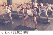 Купить «Athletic women performing step platform aerobics», фото № 28826808, снято 26 июля 2017 г. (c) Яков Филимонов / Фотобанк Лори