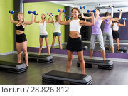 Купить «sporty women during workout in gym with dumbbells», фото № 28826812, снято 26 июля 2017 г. (c) Яков Филимонов / Фотобанк Лори
