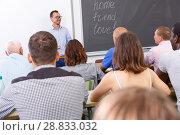 Купить «Confident lecturer talking to mixed age students», фото № 28833032, снято 28 июня 2018 г. (c) Яков Филимонов / Фотобанк Лори