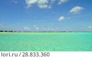 Купить «lagoon at tropical beach in french polynesia», видеоролик № 28833360, снято 3 июля 2018 г. (c) Syda Productions / Фотобанк Лори