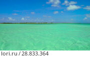 Купить «lagoon at tropical beach in french polynesia», видеоролик № 28833364, снято 1 июля 2018 г. (c) Syda Productions / Фотобанк Лори