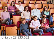 Купить «Group of people watching movie attentively», фото № 28833632, снято 3 декабря 2016 г. (c) Яков Филимонов / Фотобанк Лори