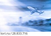 Купить «Plane on city background», фото № 28833716, снято 19 октября 2018 г. (c) Яков Филимонов / Фотобанк Лори