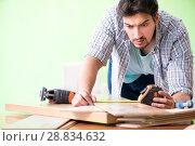 Купить «Woodworker working in his workshop», фото № 28834632, снято 15 мая 2018 г. (c) Elnur / Фотобанк Лори