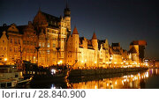 Купить «Nightlife of illuminated embankment of Motlawa river in Gdansk in summer, Poland», видеоролик № 28840900, снято 12 мая 2018 г. (c) Яков Филимонов / Фотобанк Лори