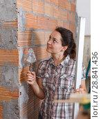 Купить «Woman working with plastering trowel», фото № 28841436, снято 19 июня 2018 г. (c) Яков Филимонов / Фотобанк Лори