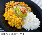 Delicious garbanzos and rice with red and green sauces. Стоковое фото, фотограф Яков Филимонов / Фотобанк Лори