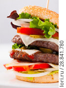 Купить «Double burger», фото № 28841780, снято 4 июля 2020 г. (c) Яков Филимонов / Фотобанк Лори