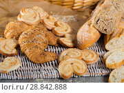 Купить «Wheat and grain baguettes, croissants and biscuits on wicker mat», фото № 28842888, снято 30 января 2018 г. (c) Яков Филимонов / Фотобанк Лори