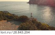 Купить «Aerial view woman do yoga at sunset», видеоролик № 28843204, снято 16 июля 2018 г. (c) Илья Шаматура / Фотобанк Лори