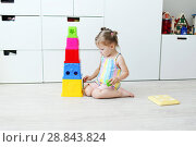 Купить «Cute 2 years toddler girl playing with educational toy at home on the floor», фото № 28843824, снято 23 июля 2018 г. (c) ivolodina / Фотобанк Лори