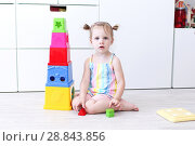 Купить «2 years toddler girl playing with educational toy at home on the floor», фото № 28843856, снято 23 июля 2018 г. (c) ivolodina / Фотобанк Лори