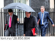 Купить «Cabinet ministers leave No 10 Downing Street following a Budget Cabinet meeting. Featuring: James Brokenshire Secretary of State for Northern Ireland,...», фото № 28850804, снято 8 марта 2017 г. (c) age Fotostock / Фотобанк Лори