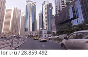 Купить «Journey on the roads among the skyscrapers of the fashionable district Dubai Marina stock footage video», видеоролик № 28859492, снято 8 апреля 2018 г. (c) Юлия Машкова / Фотобанк Лори