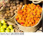 Купить «appetizing apricots in wicker baskets on counter in market», фото № 28859608, снято 26 мая 2018 г. (c) Татьяна Яцевич / Фотобанк Лори