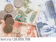 Купить «Jordanian dinars banknotes and piastres», фото № 28859708, снято 19 мая 2018 г. (c) EugeneSergeev / Фотобанк Лори