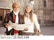 Купить «Cheerful man and woman with map», фото № 28860048, снято 18 ноября 2017 г. (c) Яков Филимонов / Фотобанк Лори
