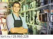 Portrait of adult male in uniform standing near shelving. Стоковое фото, фотограф Яков Филимонов / Фотобанк Лори