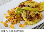 Купить «Vegetarian dish of leaves of cabbage in batter with sauce and garbanzo», фото № 28869056, снято 16 сентября 2019 г. (c) Яков Филимонов / Фотобанк Лори