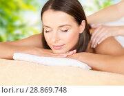 Купить «close up of beautiful woman having massage at spa», фото № 28869748, снято 25 июля 2013 г. (c) Syda Productions / Фотобанк Лори
