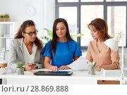Купить «businesswomen discussing papers at office», фото № 28869888, снято 17 марта 2018 г. (c) Syda Productions / Фотобанк Лори
