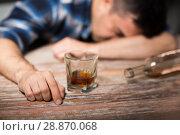 Купить «drunk man with glass of alcohol on table at night», фото № 28870068, снято 24 ноября 2017 г. (c) Syda Productions / Фотобанк Лори