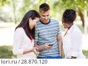 Купить «group of happy friends with smartphone outdoors», фото № 28870120, снято 10 июня 2018 г. (c) Syda Productions / Фотобанк Лори